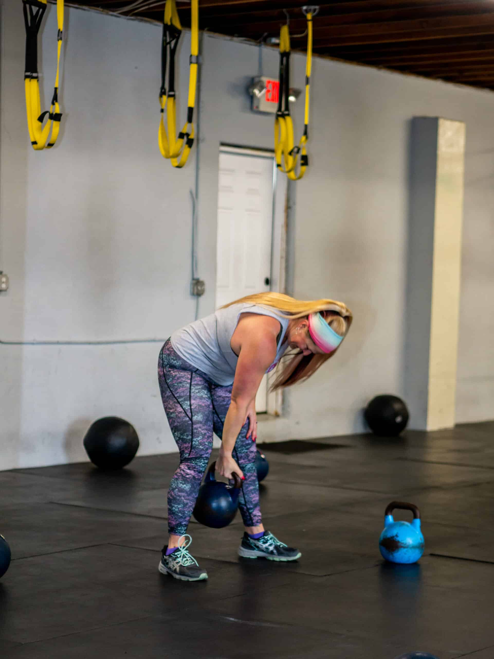 Spark Fitness member training with kettlebells at the fitness center