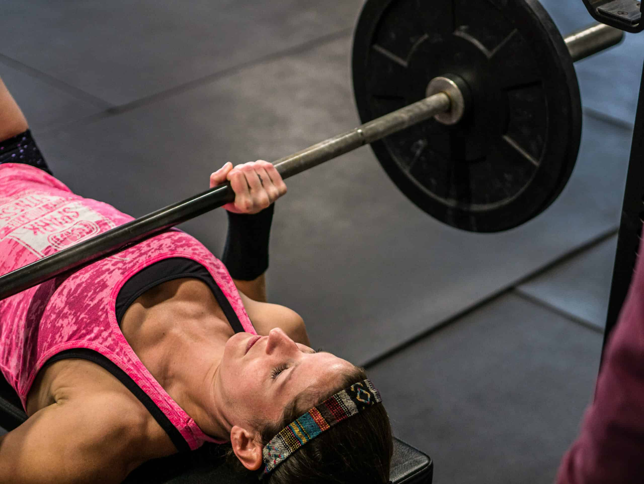 Spark Fitness team member weightlifting at the fitness center