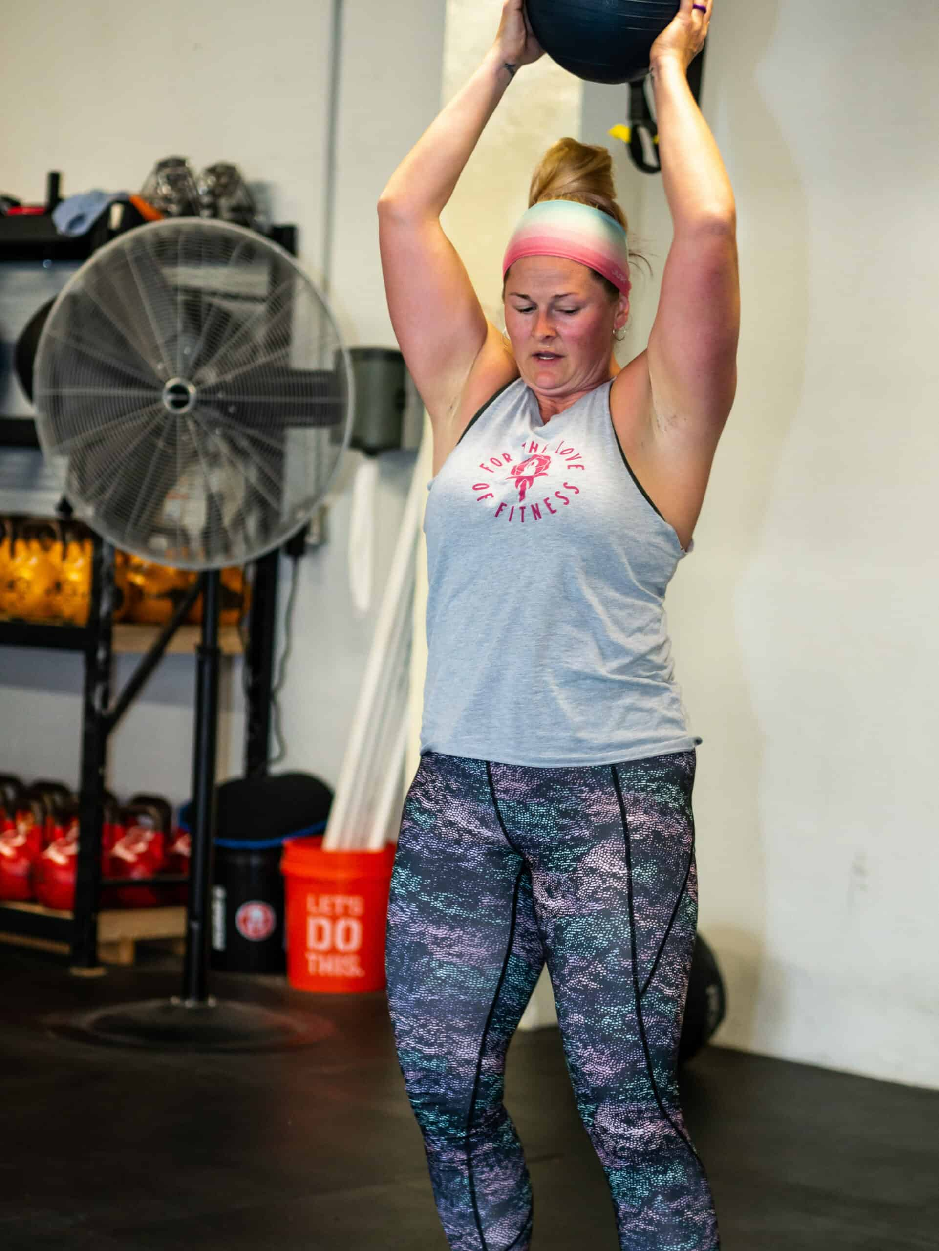 Spark Fitness team member training with a medicine ball at the fitness center