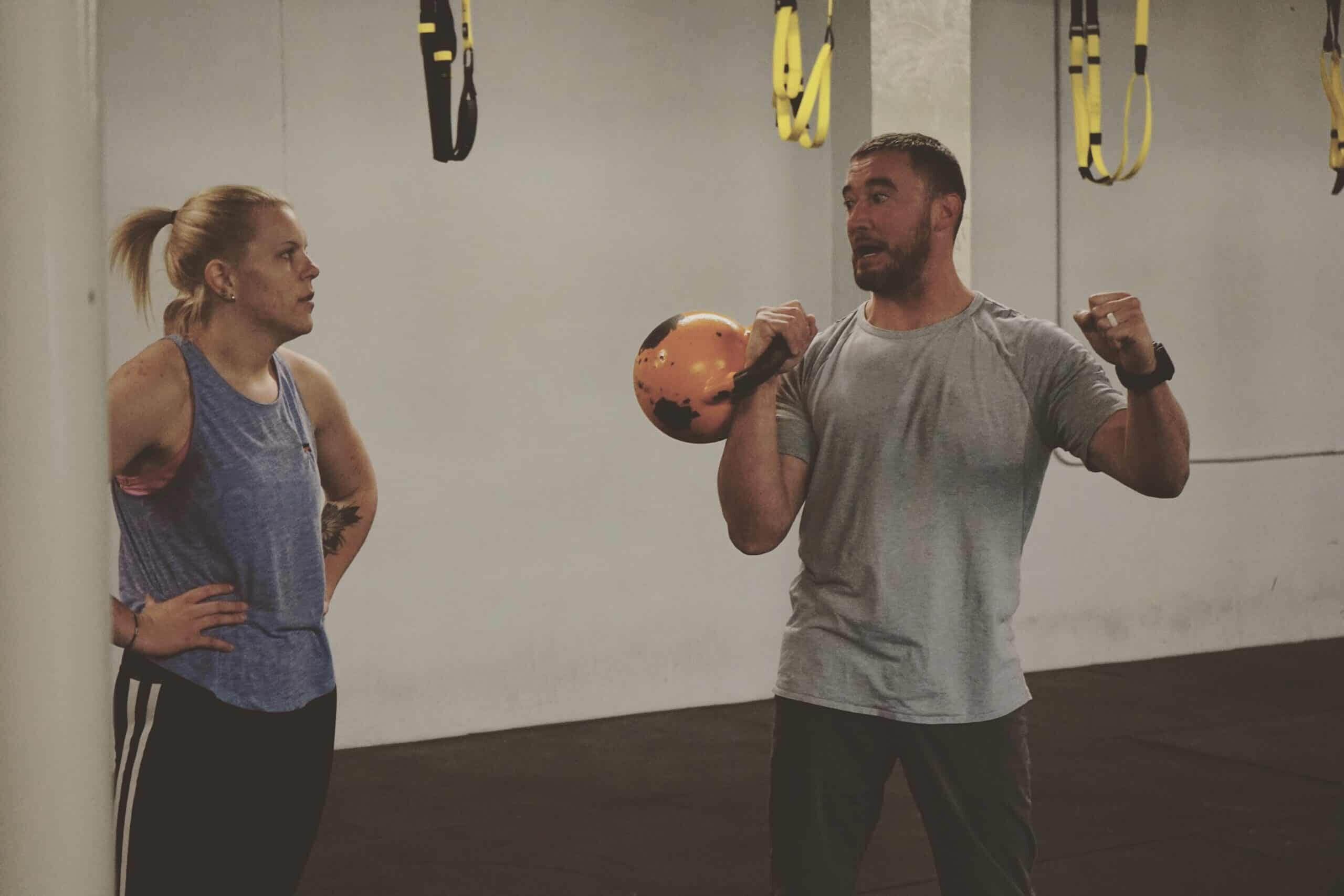 Spark Fitness member in a kettlebell training session with fitness coach Kevin Byrnes