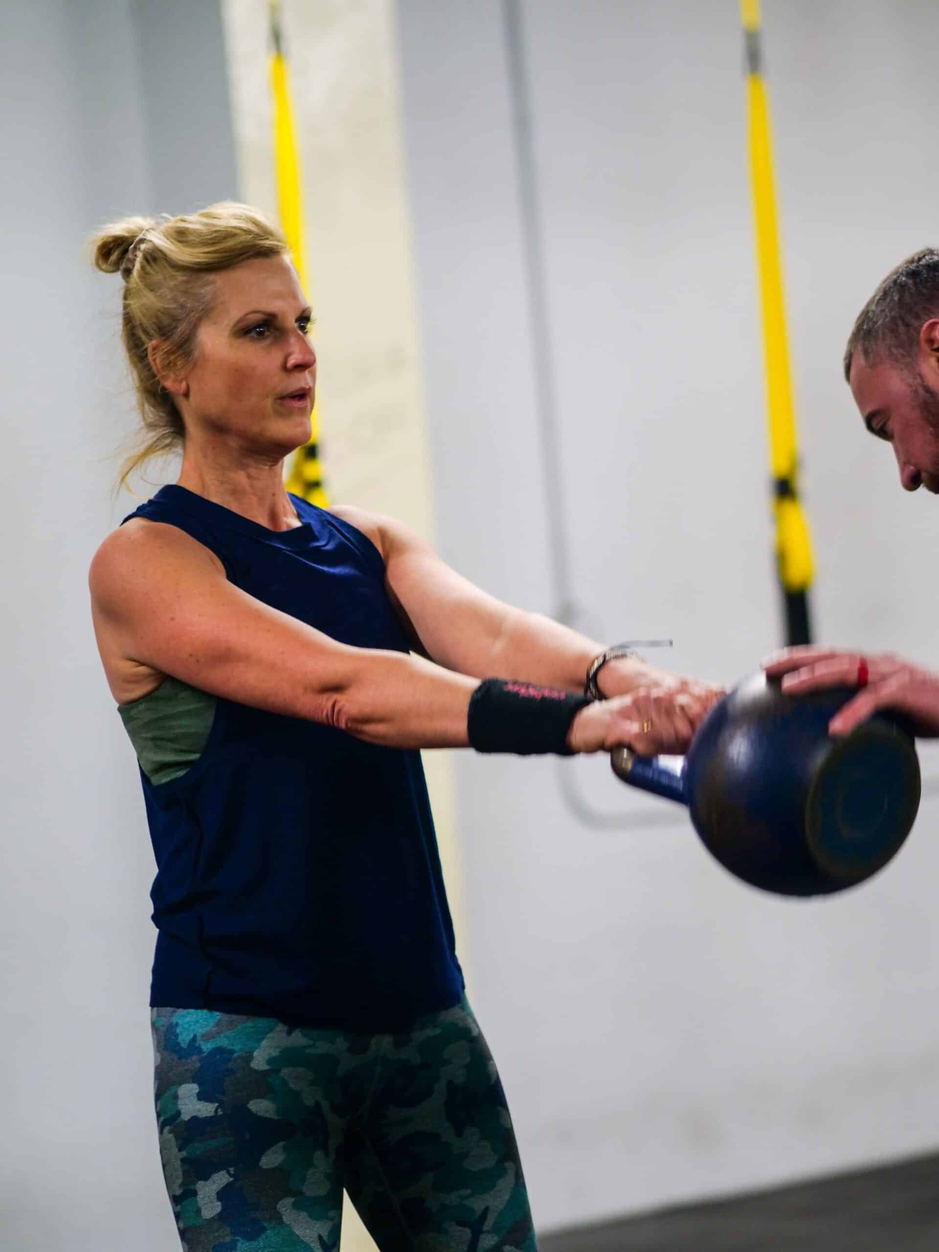 Spark Fitness team member training with a kettlebell
