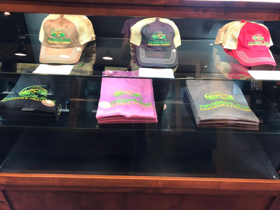 Hats and shirts for sale at Timberline Firearms