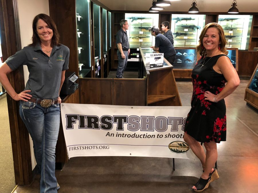 Timberline Firearms employees standing with First Shots banner