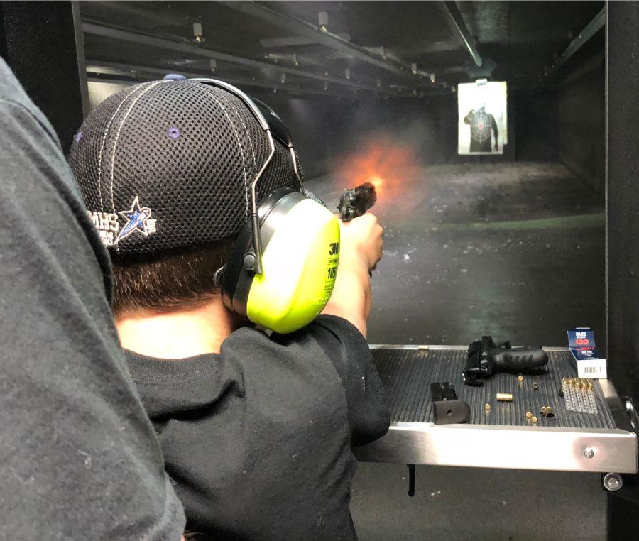 Man shooting at target at Timberline Firearms