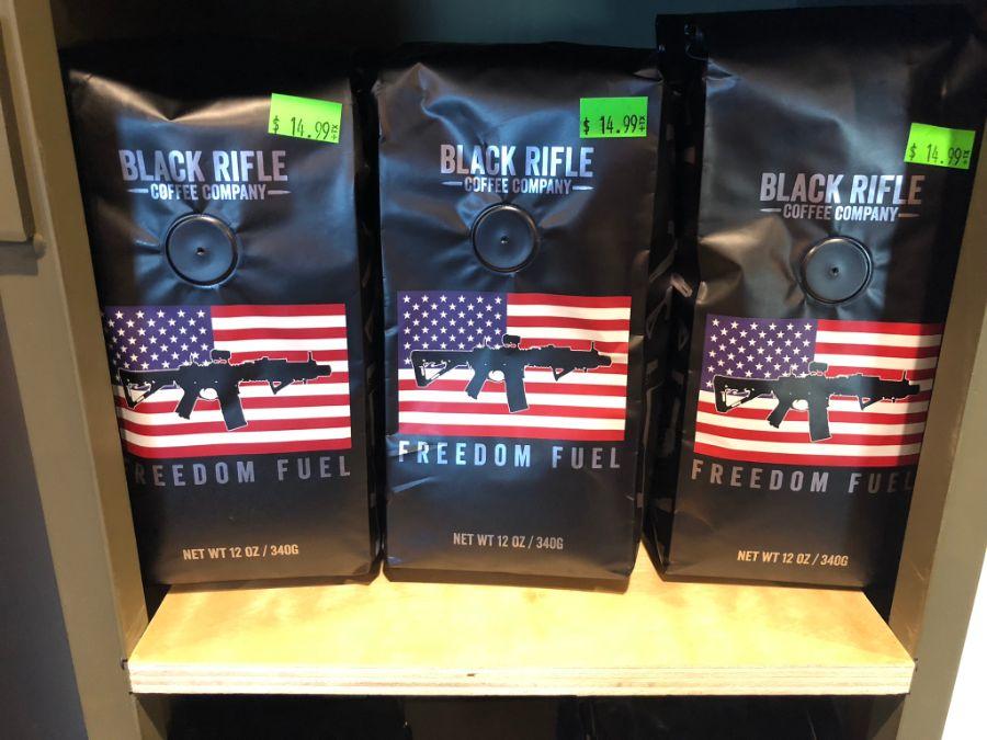 Bags of Black Rifle Coffee Company coffee on a shelf at Timberline Firearms