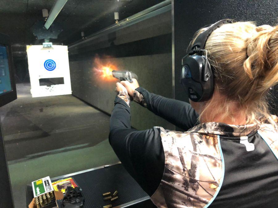 Woman shooting at target at Timberline Firearms shooting Range