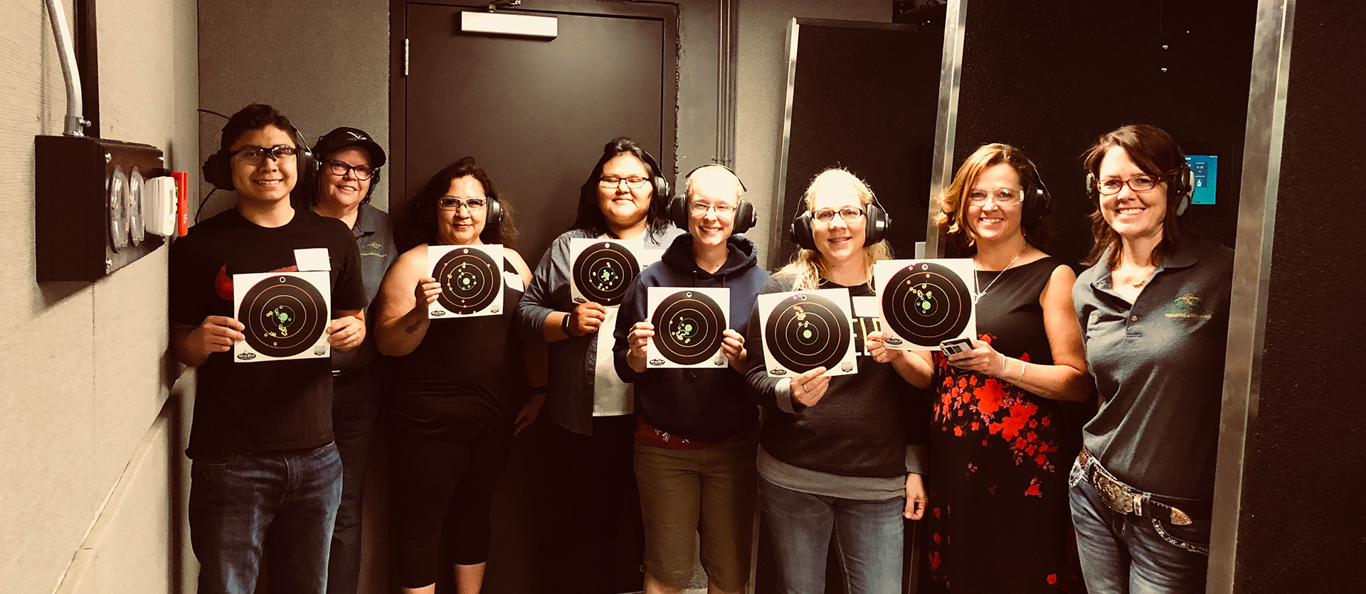Women shooters with targets at Timberline Firearms