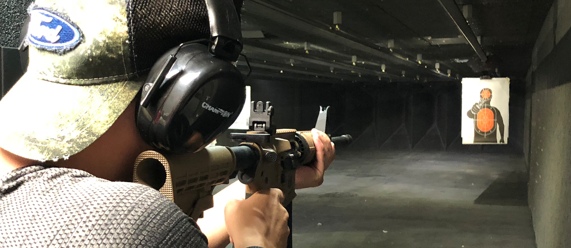 Shooter shooting with AR15 at Timberline Firearms