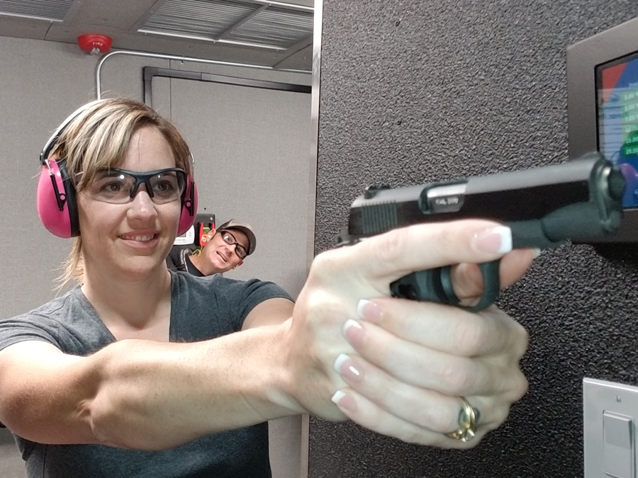Close-up of first time shooter holding a handgun at Timberline Firearms