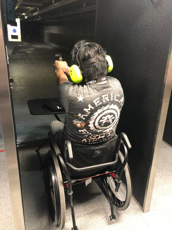 Man in a wheelchair shooting at Timberline Firearms.