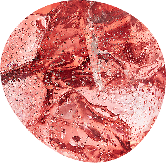 Close up of pink Harmless Harvest Coconut Water with ice cubes