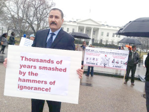 A protester is seen Tuesday outside the White House to urge the administration to stop ISIS from destroying ancient artifacts in Iraq and Syria. (Marie Helene Carleton/Four Corners Media)