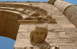 In this July 27, 2005 file photo, the face of a woman stares down at visitors in the Hatra ruins, 200 miles north of Baghdad, Iraq. Iraq's minister of tourism and antiquities told the AP on Saturday that the government is investigating reports that the ancient archaeological site of Hatra in northwestern Iraq is being demolished by militants from the Islamic State group. (AP)
