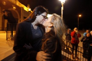Kissing Brides, Heather Jensen and Amy Quinn, an Asbury Park Councilwoman, celebrate their marriage shortly after midnight on October 21. facebook photo