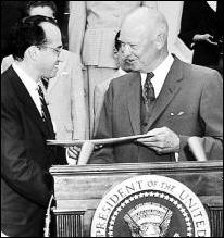 Dr. Jonas Salk receiving a Gold Medal from President Eisenhower (January 27, 1956).