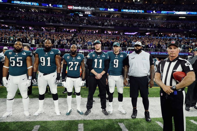 MINNEAPOLIS, MN - FEBRUARY 04: Brandon Graham #55, Fletcher Cox #91, Malcolm Jenkins #27, Carson Wentz #11 and Nick Foles #9 of the Philadelphia Eagles stand for the national anthem prior to Super Bowl LII against the New England Patriots at U.S. Bank Stadium on February 4, 2018 in Minneapolis, Minnesota. (Photo by Elsa/Getty Images)