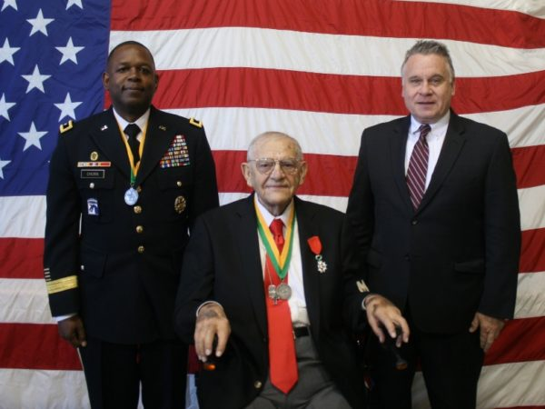 Walter Pruiksma, center, wearing his Silver Marechausee Medal, Major Gen. Phillip Churn, Sr., left and Congressman Chris Smith, right, Oct 13, 2018, Manasquan Presbyterian Church. -photo by Art Gallagher