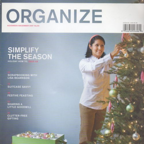 "Cover of ""Organize"" magazine of woman decorating a christmas tree"