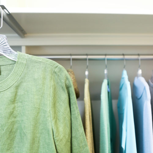 Organized closet with hanging clothes