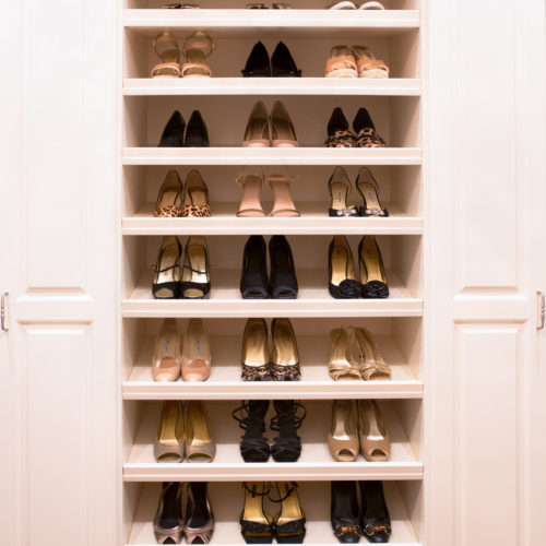 Organized shoes on shelves