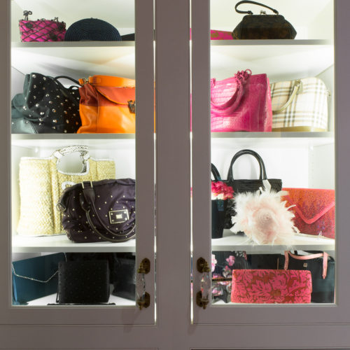 Handbags inside lighted glass cabinet