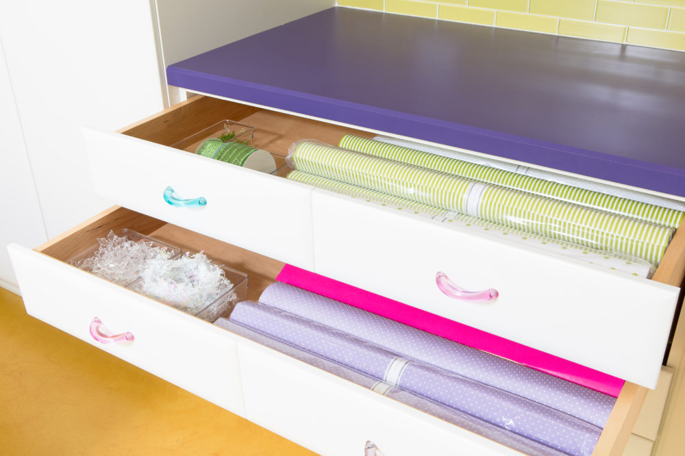 Craftroom drawers organized with rolls of wrapping paper