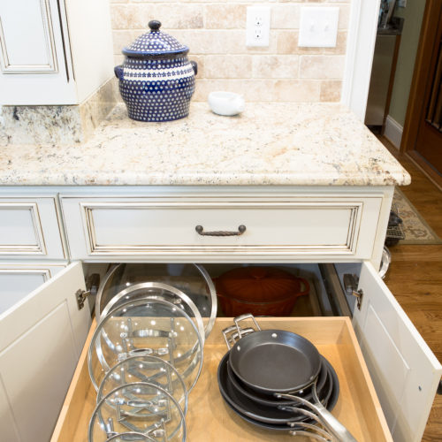 organized kitchen pull out drawer with pots and pans