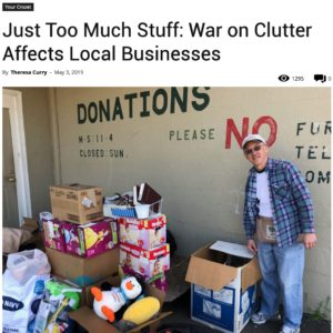 Man next to piles of donations