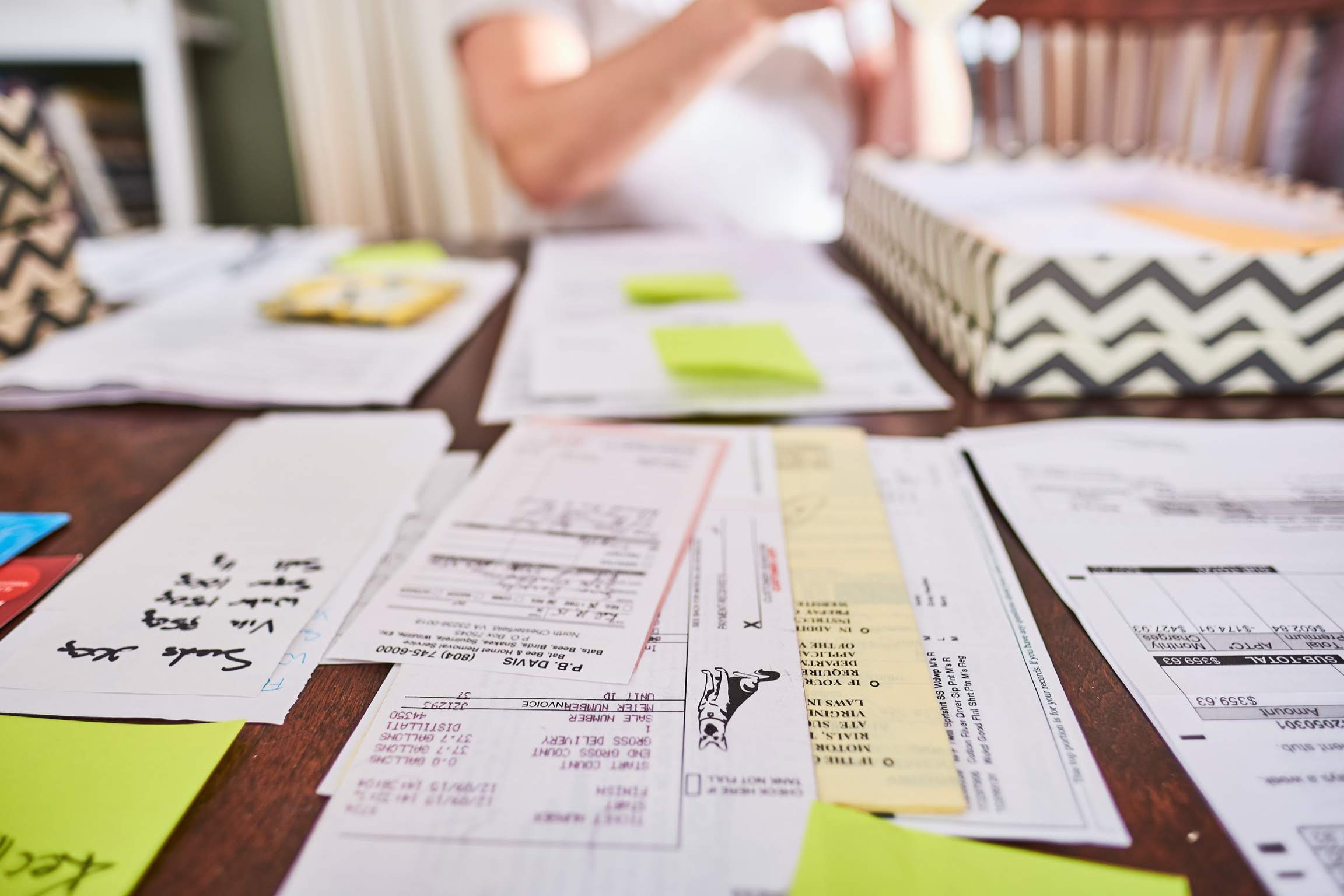 Sorted piles of paper on table