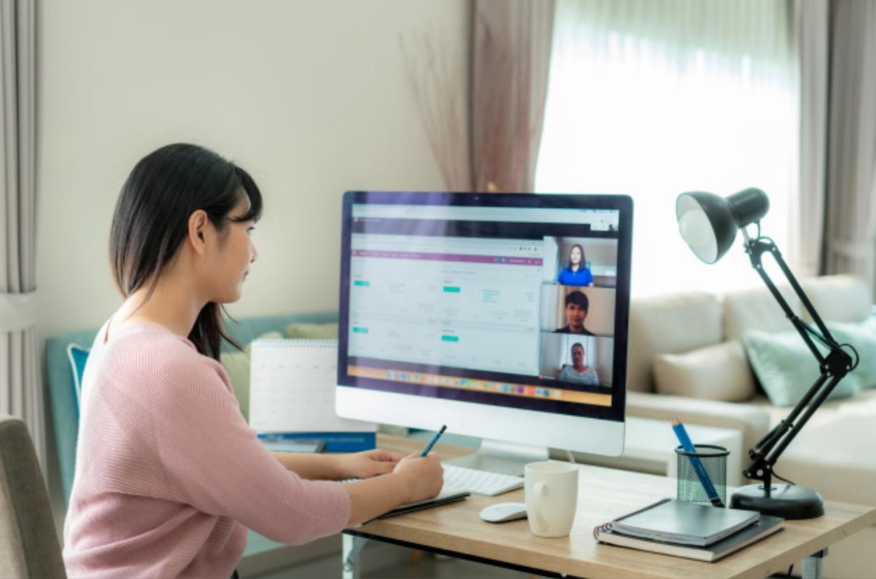 Woman at desk having a virtual meeting