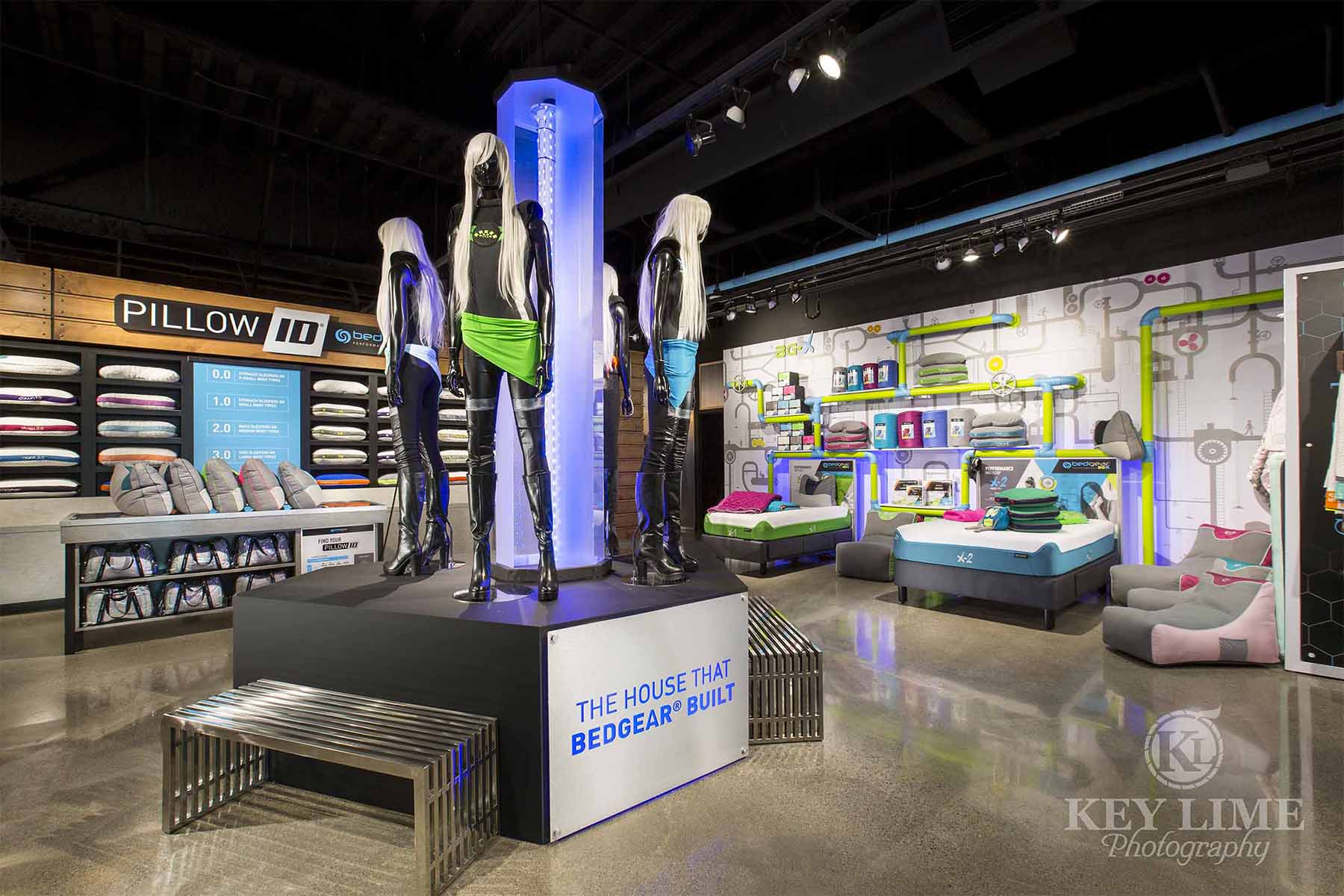 Trade show photographer image of showroom entry. Bedding and shiny black mannequins.