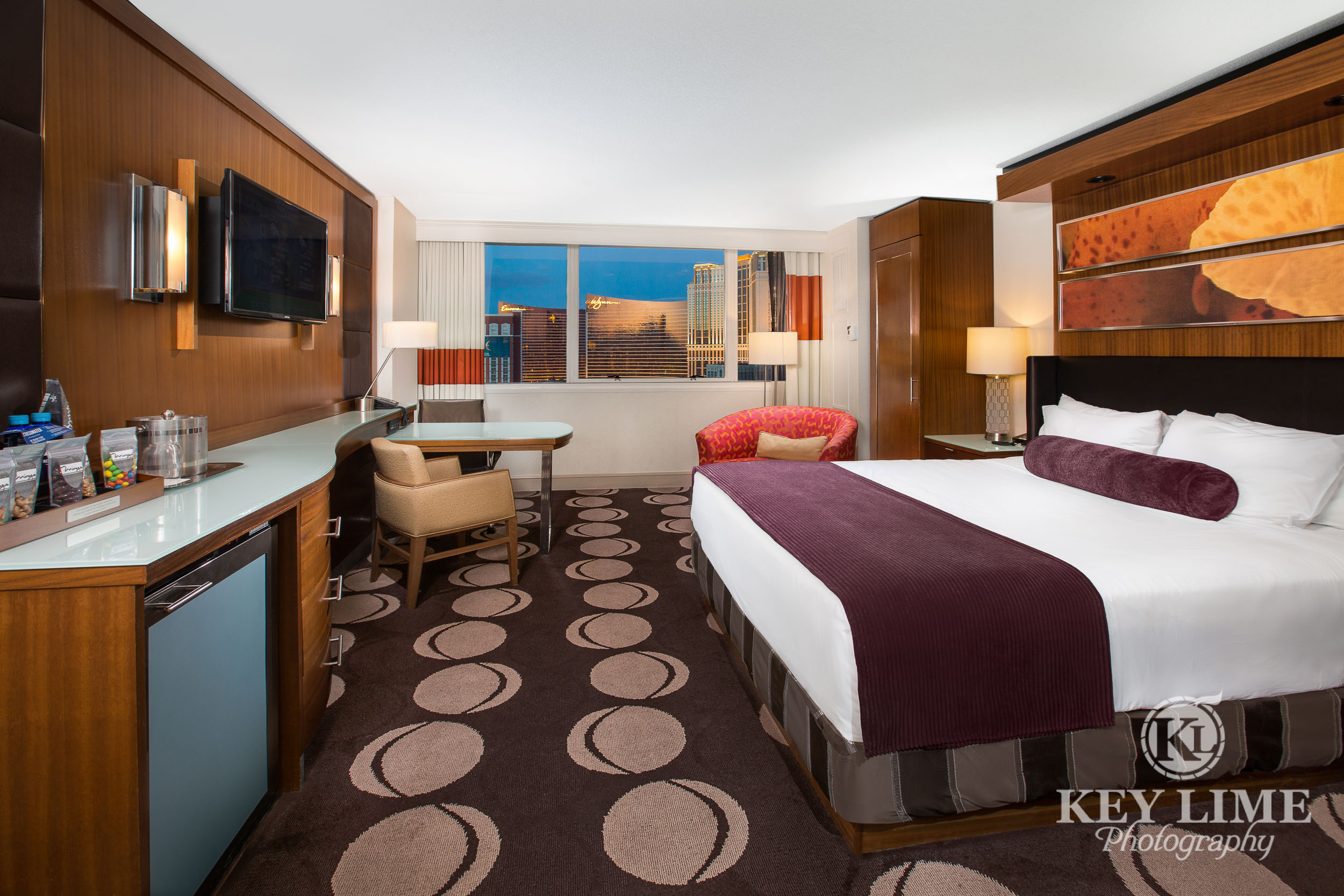 Resort hotel suite. Architectural photographer image of room with TV and a single king size bed.