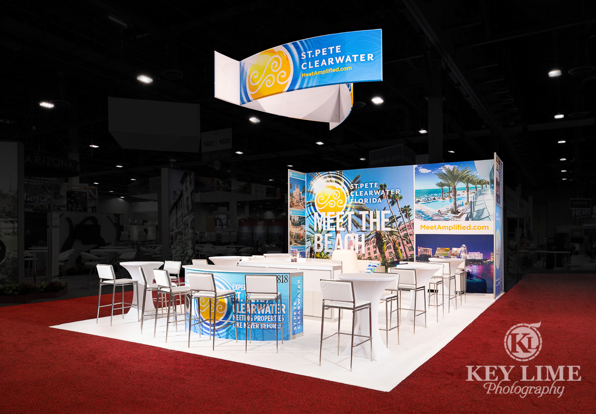 Trade show photographer image of booth on red carpet and black ceiling