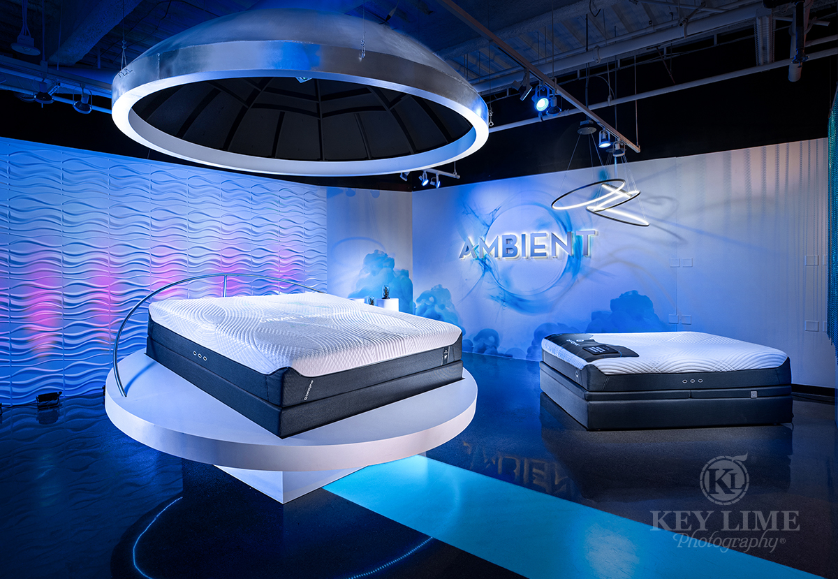 Las Vegas Market trade show photographer image of mattress. Blue room with bed raised on a futuristic platform. Hero image