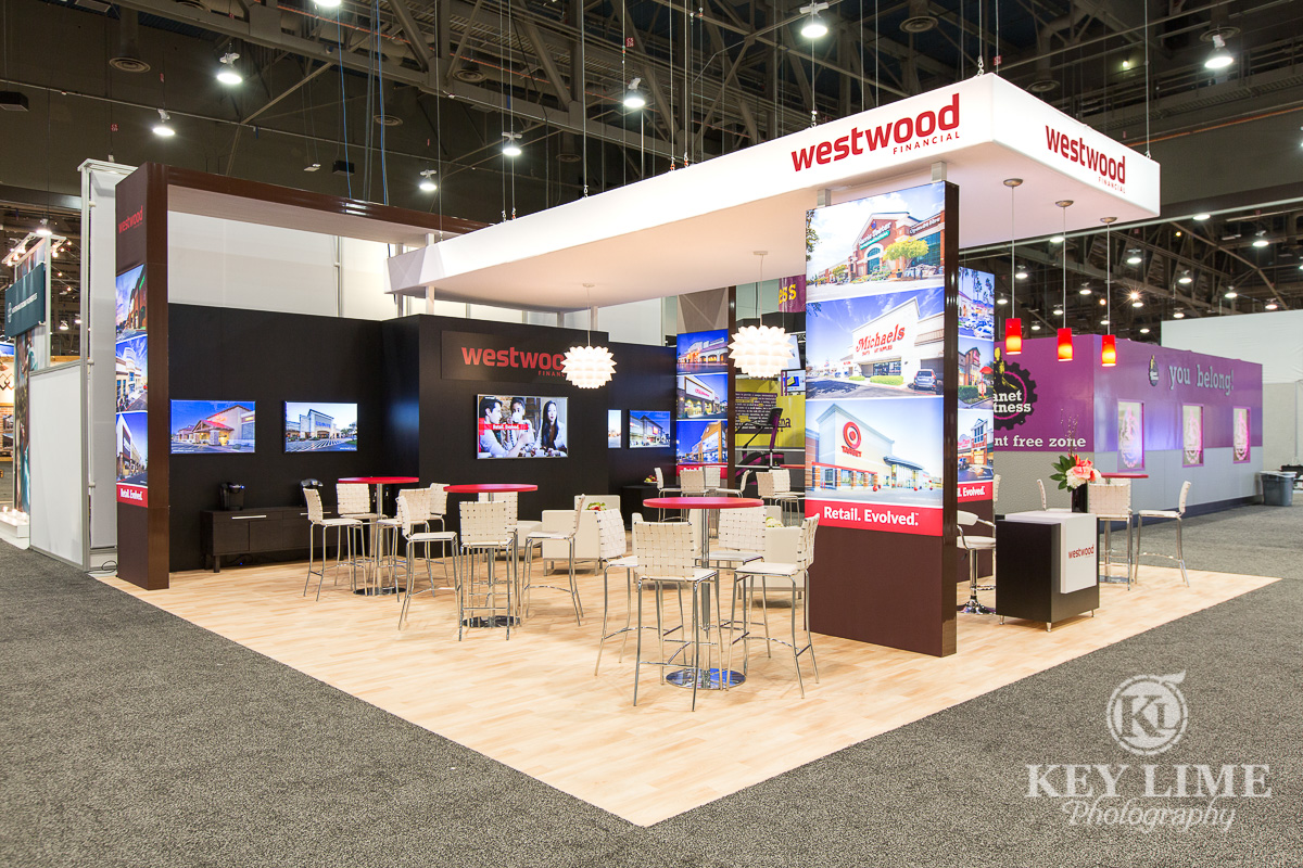 trade show photgrapher image of red and white booth design