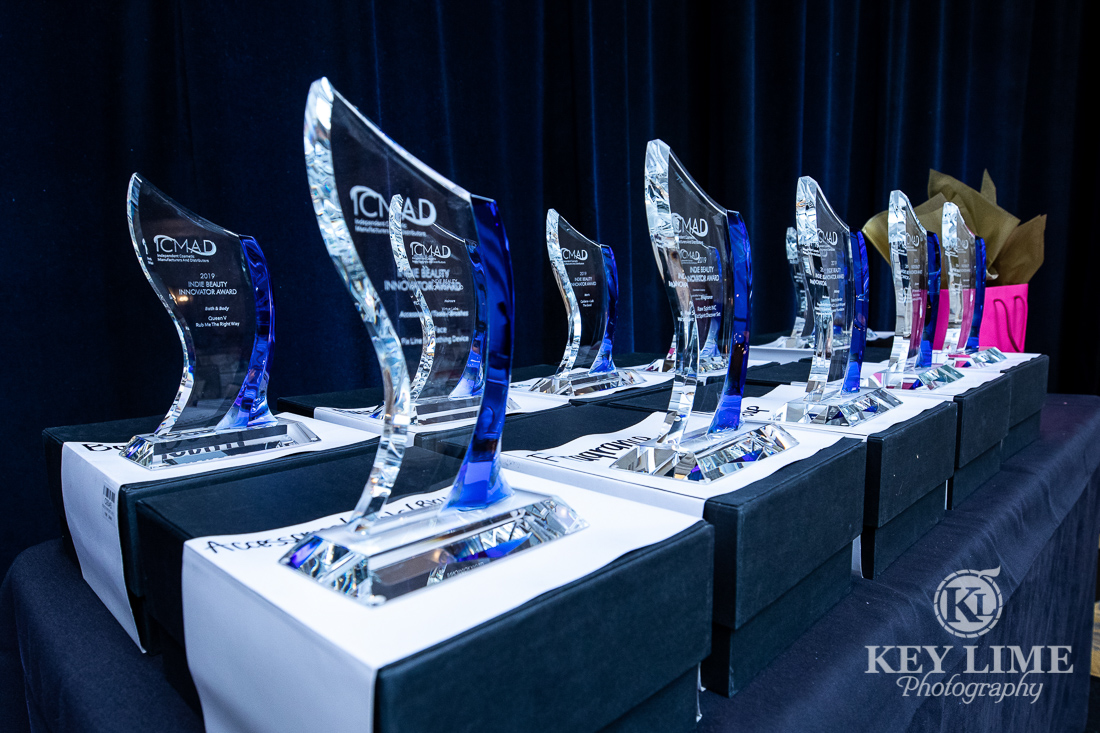 awards displayed on a table. Trade show after party photographer