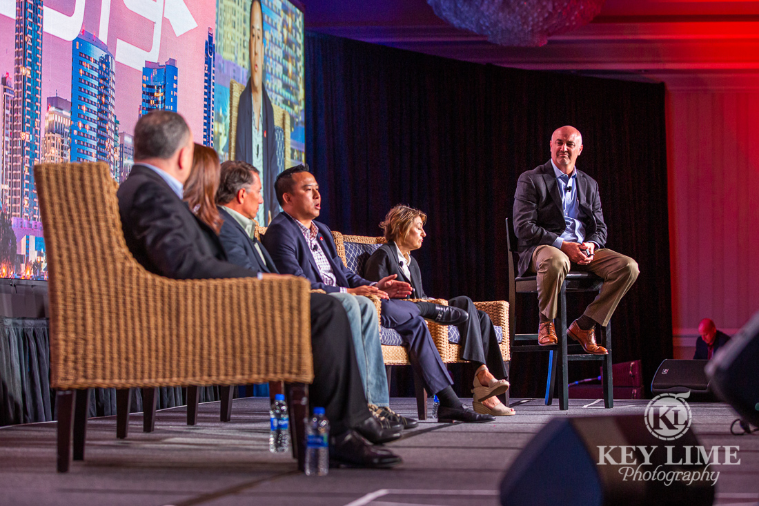 Panel discussion onstage at a conference