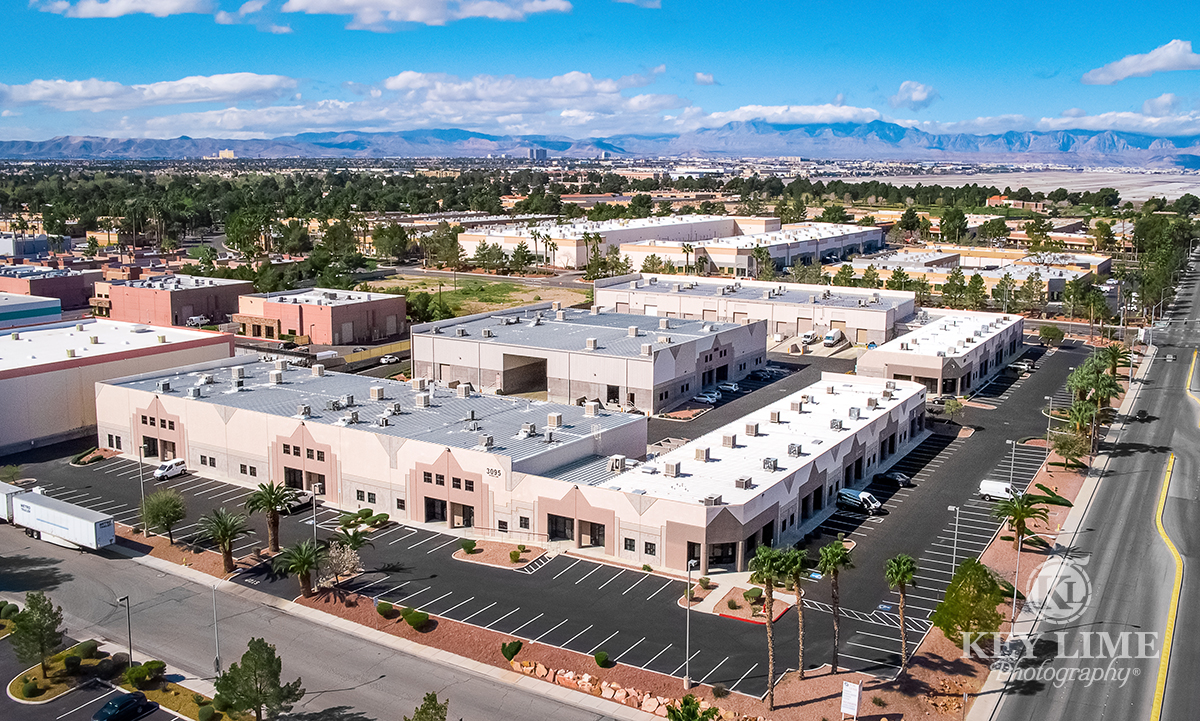 Drone architecture photographer photo of business center in Las Vegas. Vivid blue sky and lush green neighborhoods.