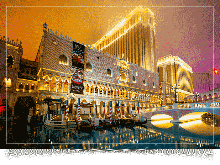 Las Vegas photographer image of the colonnade at Doge's Palace architecture. Bright and vibrant yellow, teal and pink hues. Majestic lighting with low clouds