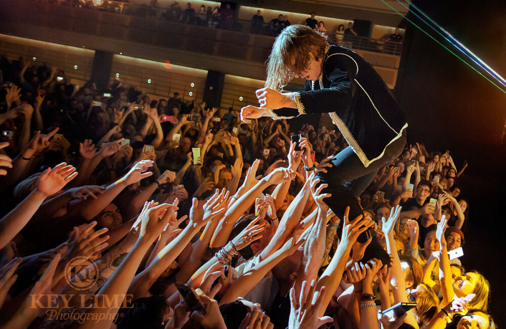 Iconic photo of Cage the Elephant by concert photographer Key Lime Photo. Lead singer Matt Schultz performing his signature crowd surf.