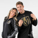 Man and woman smiling with Golden Knights clothing. Product photography in Las Vegas.