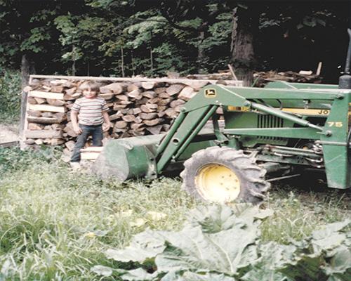 Old-802-kid-stacking-wood-500x4001