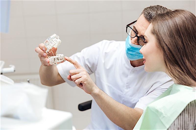 Dental Technician Working on Implants
