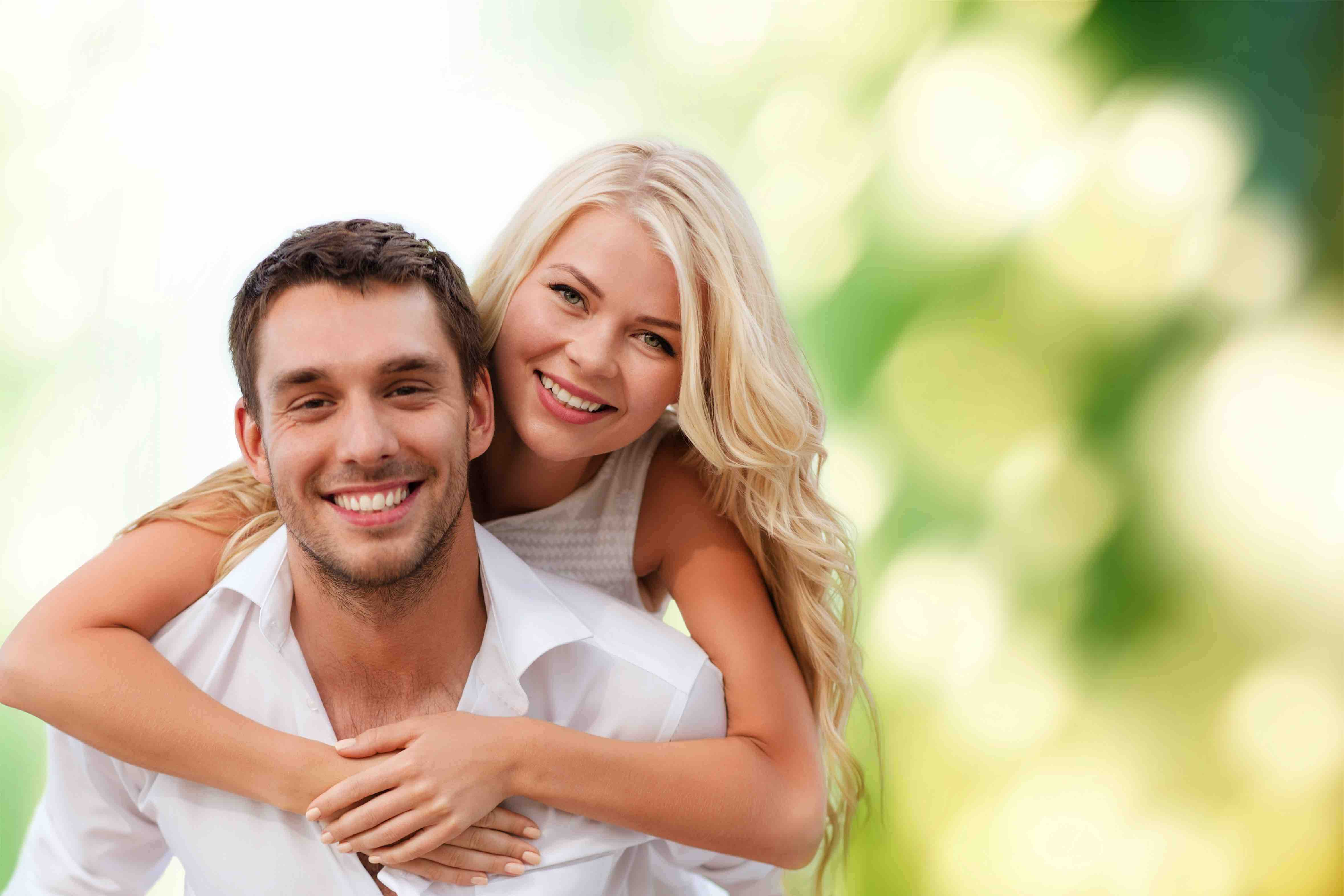 Young Couple Smiling With Dental Implants in Birmingham Alabama