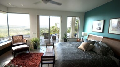 Master bedroom for a custom home build with lots of glass and a great view