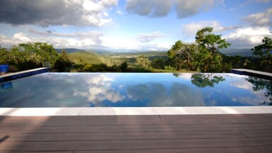 Custom home built on a hillside with an infinity pool overlooking the Willamette Valley