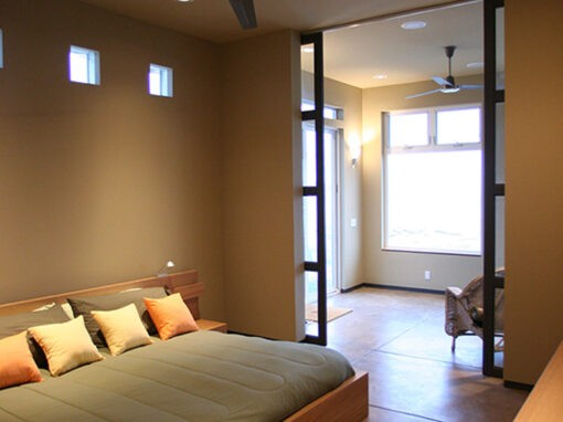 Bedroom for a custom home in Oregon with radiant heat and sliding barn doors