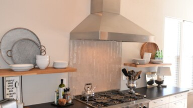 Kitchen remodeled in white Shakers with stainless steel appliances