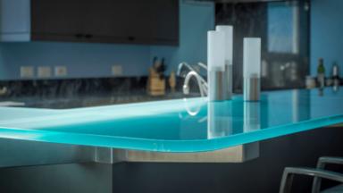 Modern kitchen with glass bar top