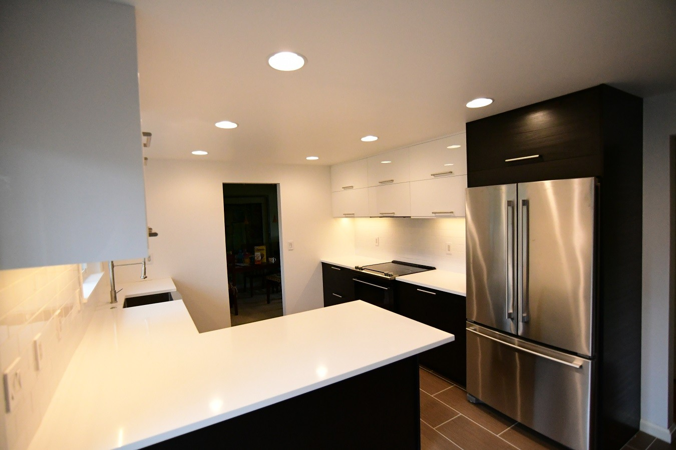 Portland remodeling project features black kitchen cabinets with white horizontal uppers